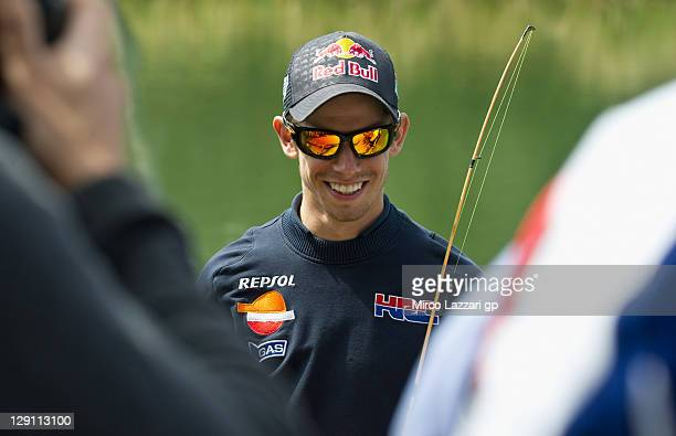 Casey Stoner of Australia and Repsol Honda Team smiles during the preevent 'Trout fishing' prior to the Australian MotoGP which is round 16 of the...