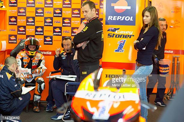 Casey Stoner of Australia and Repsol Honda Team speaks in box with mechanics in front of his wife Adriana Stoner of Australia during the free...