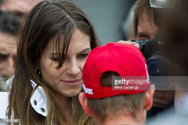 Casey Stoner of Australia and Repsol Honda Team speaks with his wife Adriana Stoner at the end of the qualifying practice for the Australian MotoGP...