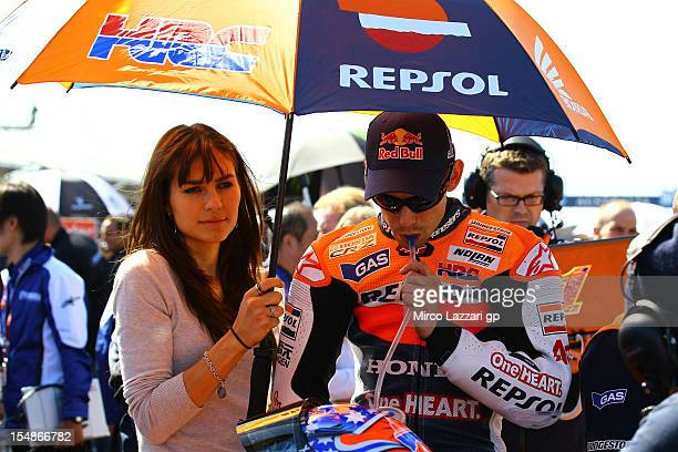 Casey Stoner of Australia and Repsol Honda Team takes a drink as he prepares to start on the grid with his wife Adriana during the Australian MotoGP...