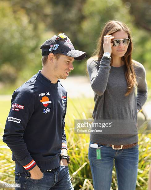 Casey Stoner of Australia and rider of the Repsol Honda Team Honda is seen with his wife Adriana prior to the Australian MotoGP which is round 16 of...