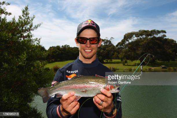 Casey Stoner of Australia and rider of the Repsol Honda Team Honda poses with a trout prior to the Australian MotoGP which is round 16 of the MotoGP...