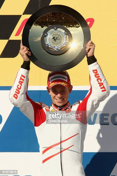 Casey Stoner of Australia and the Ducati Marlboro Team celebrates on the podium after winning the Australian MotoGP, which is round 15 of the MotoGP...
