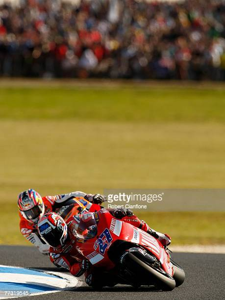 Casey Stoner of Australia and the Ducati Team leads Nicky Hayden of the USA and the Repsol Honda Team into turn four during the 2007 Australian...