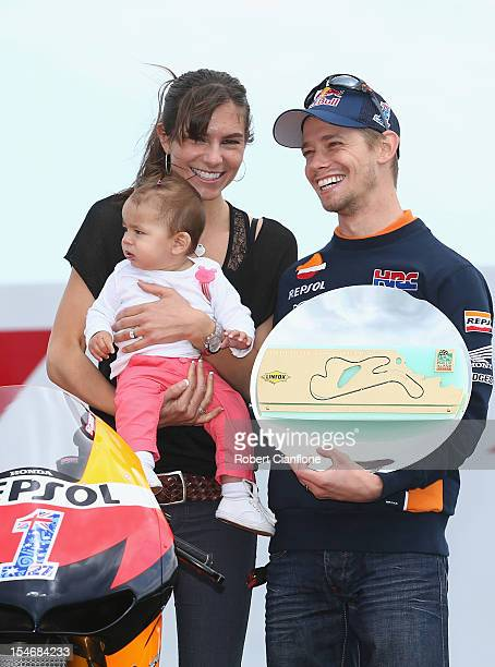 Casey Stoner of Australia and the Repsol Honda Team poses with his wife Adriana and baby daughter Alessandra Maria after turn three of the Phillip...