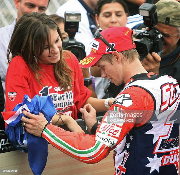 Casey Stoner of Australia Ducati Marlboro team is congratulated by his wife Adriana after the MotoGP race at the Japanese Grand Prix in Twin Ring...