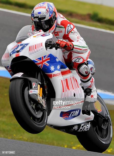 Casey Stoner of Australia lifts the front wheel of his Ducati during the warmup session for the Australian MotoGP Grand Prix at Phillip Island on...