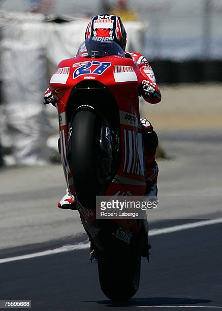 Casey Stoner of Australia rider of the Ducati makes a wheelie after winning the 2007 Red Bull US Grand Prix part of the MotoGP World Championships at...