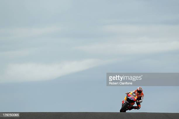 Casey Stoner of Australia rides the Repsol Honda Team Honda during qualifying for the Australian MotoGP which is round 16 of the MotoGP World...