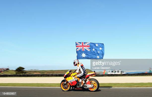 Casey Stoner of Australia riding the Repsol Honda Team Honda celebrates after winning the Australian MotoGP which is round 17 of the MotoGP World...