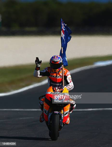 Casey Stoner of Australia riding the Repsol Honda Team Honda celebrates after winning the Australian MotoGP, which is round 17 of the MotoGP World...