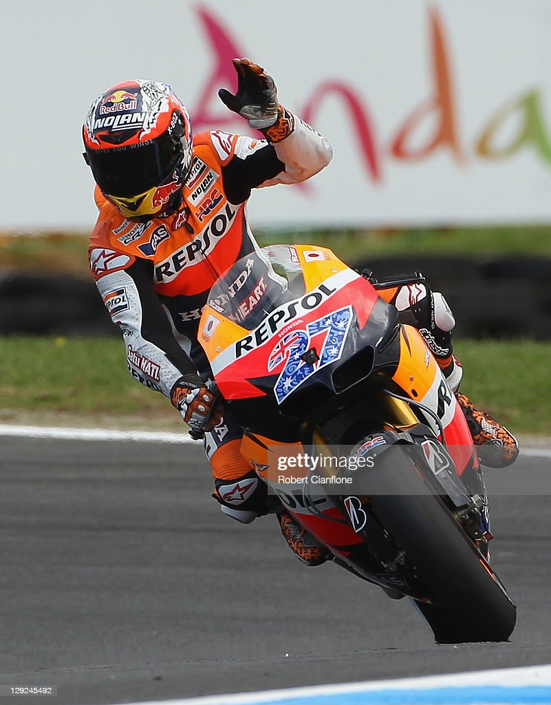 Casey Stoner of Australia riding the #27 Repsol Honda Team Honda waves to the crowd after qualifying in pole position for the Australian MotoGP, which is round 16 of the MotoGP World Championship, at Phillip Island Grand Prix Circuit on October 15, 2011 in Phillip Island, Australia.