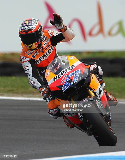 Casey Stoner of Australia riding the Repsol Honda Team Honda waves to the crowd after qualifying in pole position for the Australian MotoGP which is...