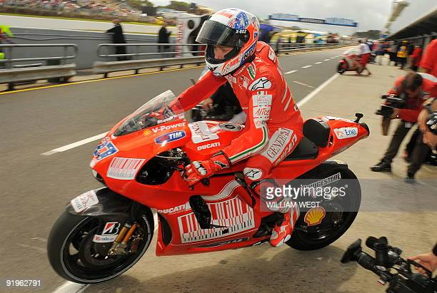 Casey Stoner of Australia speeds out of the pits on his Ducati during qualifying for the Australian MotoGP Grand Prix at Phillip Island some 100kms...