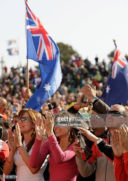 Casey Stoner's wife Adriana cheers as he celebrates on the podium after winning the 2007 Australian Motorcycle Grand Prix held at Phillip Island...