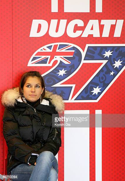 Casey Stoner's wife Adriana Stoner looks on in the Ducati Marlboro Team pits during free practice for the MotoGP World Championship Grand Prix of...