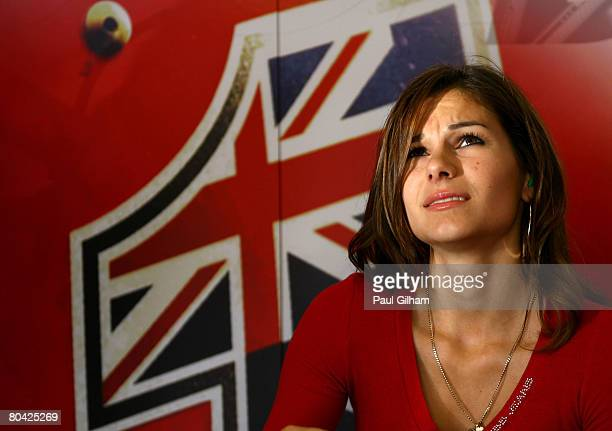 Casey Stoner's wife Adriana Tuchyna looks on from the back of the team garage during the practice session prior to qualifying for the MotoGP of Spain...