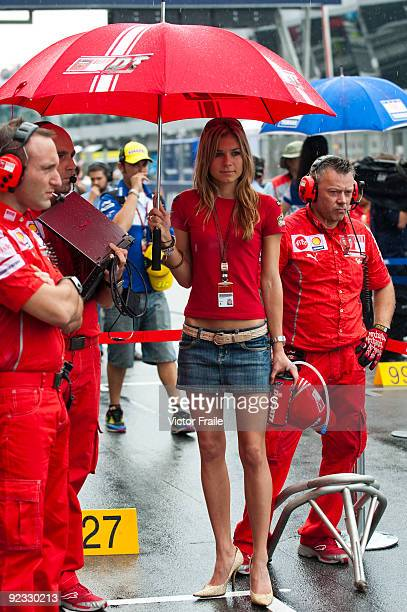 Casey Stoner's wife Adriana Tuchyna wait for her husband at the grid before the start of the Malaysian MotoGP which is round 16 of the MotoGP World...
