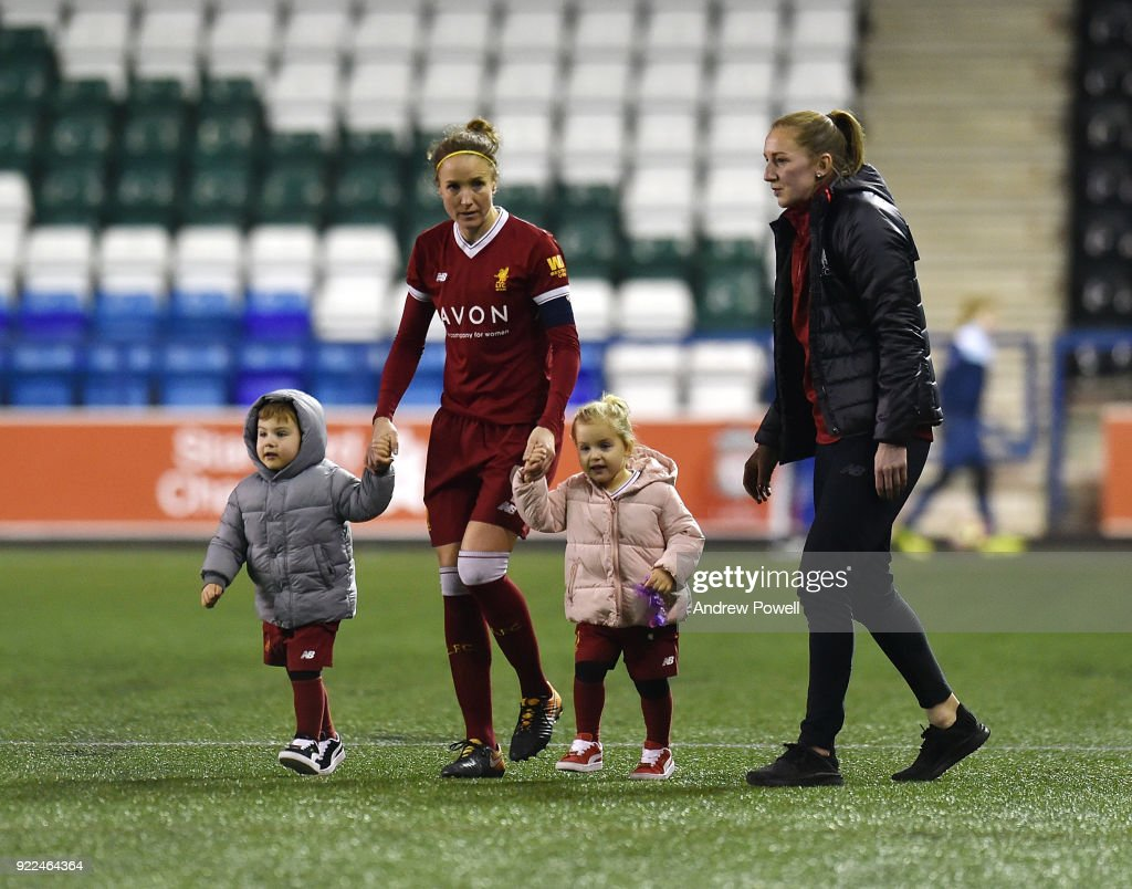 Casey Stoney and Siobhan Chamberlain of Liverpool Ladies with Casey's children at the end of the FA WSL match between Liverpool Ladies and Sunderland Ladies at Select Security Stadium on February 21, 2018 in Widnes, England.