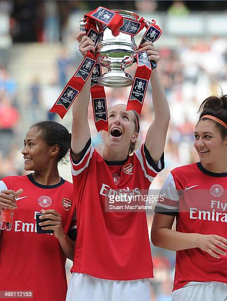 Casey Stoney lifts the FA Cup after the Arsenal victory at Stadium mk on June 1 2014 in Milton Keynes England