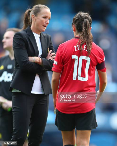 Casey Stoney manager of Manchester United speaks with Katie Zelem of Manchester United after the Barclays FA Women's Super League match between...