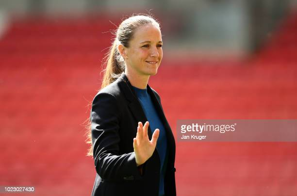 Casey Stoney Manager of Manchester United Women waves prior to the FA WSL Continental Tyres Cup match between Manchester United and Reading at Leigh...