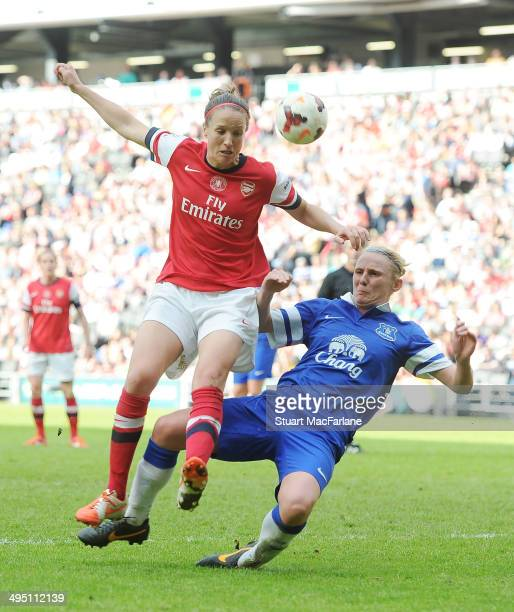 Casey Stoney of Arsenal challenged by Lindsay Johnson of Everton during the match at Stadium mk on June 1 2014 in Milton Keynes England