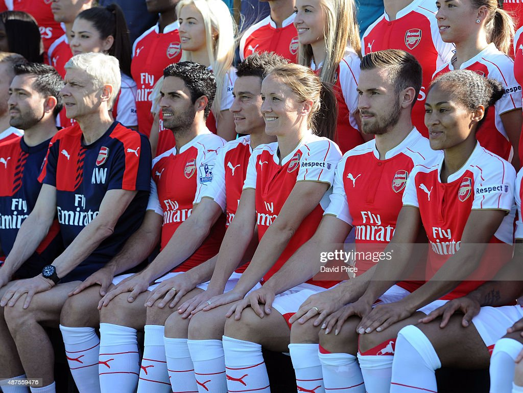 Casey Stoney of Arsenal Ladies (C) looks on during the Arsenal 1st Team Group Photograph at London Colney on September 10, 2015 in St Albans, England.
