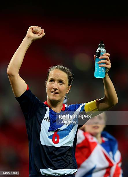 Casey Stoney of Great Britain waves to the crowd draped in a Union Jack as she celebrates her team's victory after the Women's Football first round...