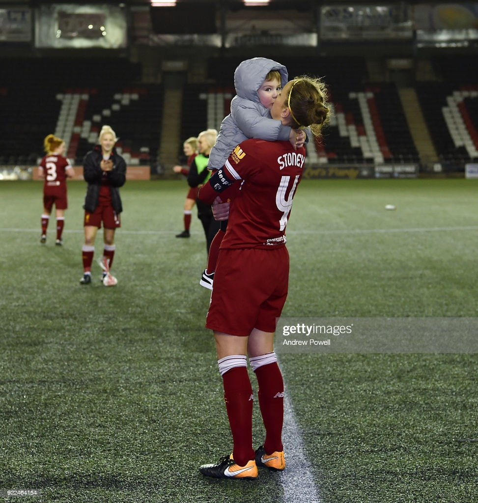 Casey Stoney of Liverpool Ladies embracing her child at the end the FA WSL match between Liverpool Ladies and Sunderland Ladies at Select Security Stadium on February 21, 2018 in Widnes, England.