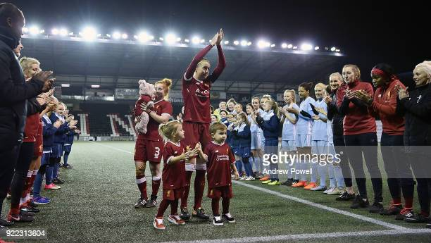 Casey Stoney of Liverpool Ladies walks out to a guard of honour with her three children before the FA WSL match between Liverpool Ladies and...