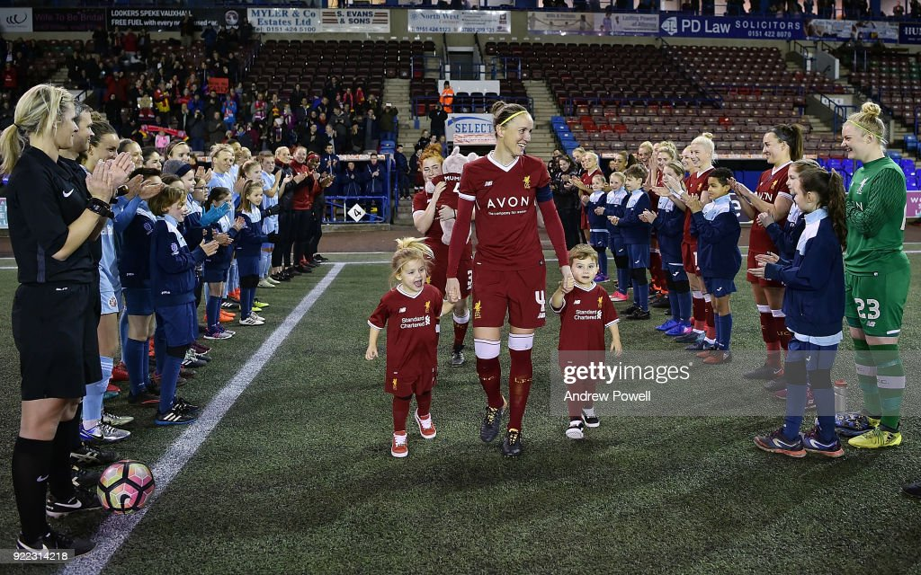 Casey Stoney of Liverpool Ladies walks out to a guard of honour with her three children before the FA WSL match between Liverpool Ladies and Sunderland Ladies at Select Security Stadium on February 21, 2018 in Widnes, England.