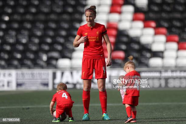 Casey Stoney of Liverpool Ladies with her children after the SSE FA Women's Cup Sixth Round match at Select Security Stadium on March 26, 2017 in...