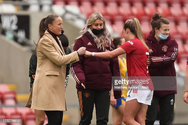 Casey Stoney the head coach / manager of Manchester United Women fist bumps Ella Toone of Manchester United Women at full time during the Barclays FA...