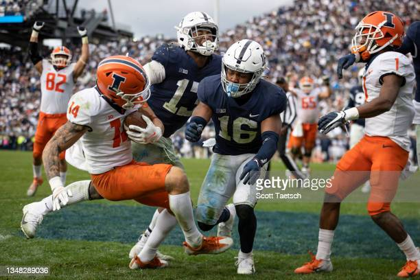 Casey Washington of the Illinois Fighting Illini catches a two point conversion in the ninth overtime to win the game against the Penn State Nittany...