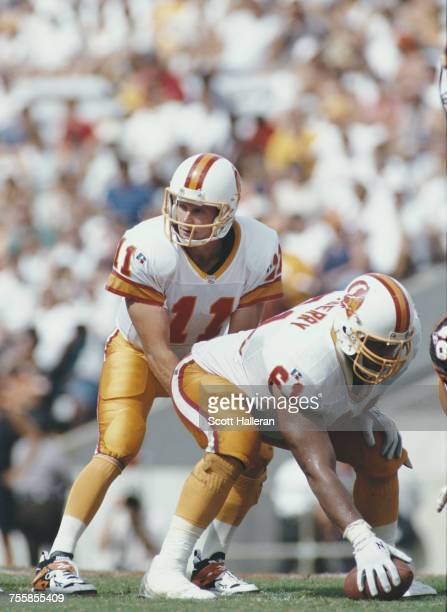 Casey Weldon Quarterback for the Tampa Bay Buccaneers prepares to take the snap from Tony Mayberry during their National Football Conference Central...
