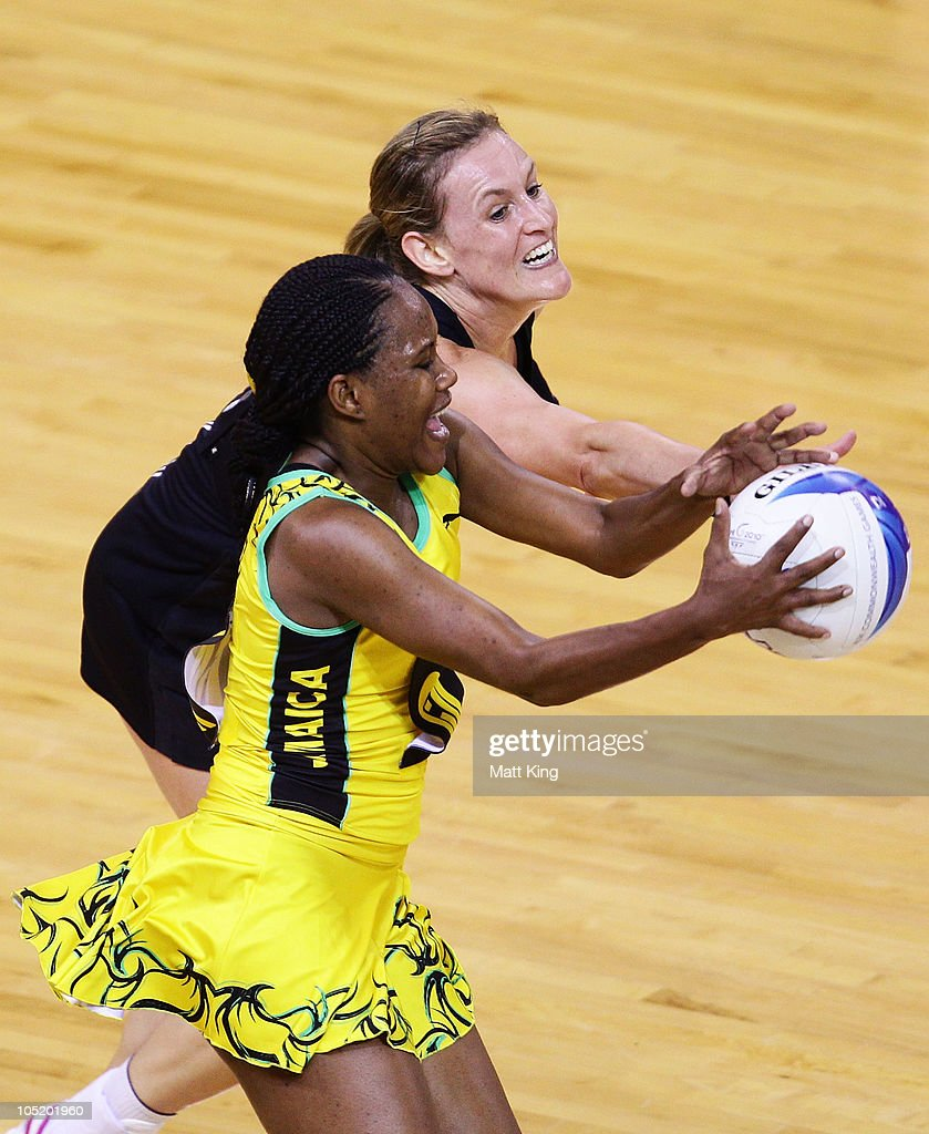 Casey Williams of New Zealand and Simone Forbes of Jamaica compete for the ball during the Women Semifinals Match between New Zealand and Jamaica at the Thyagaraj Sports Complex during day nine of the 2010 Commonwealth Games on October 12, 2010 in Delhi, India.