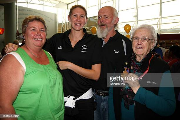 Casey Williams of the Silver Ferns poses with her Mother Joanne Father Murray and Nana Beryl Rusk on her arrival at Auckland International Airport on...