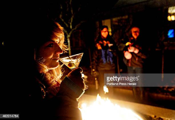 Casey Zalucki of Portland sips a dirty martini by the fire at the Ice Bar at the Portland Harbor Hotel Thursday January 22 2015