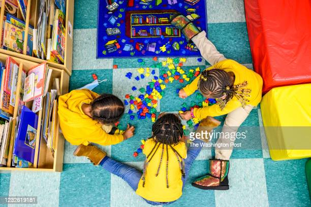 Cash Cain, Brielle Kelly, and Journee Simon, play together n the three-year-olds class at Little Flowers Early Childhood and Development Center...