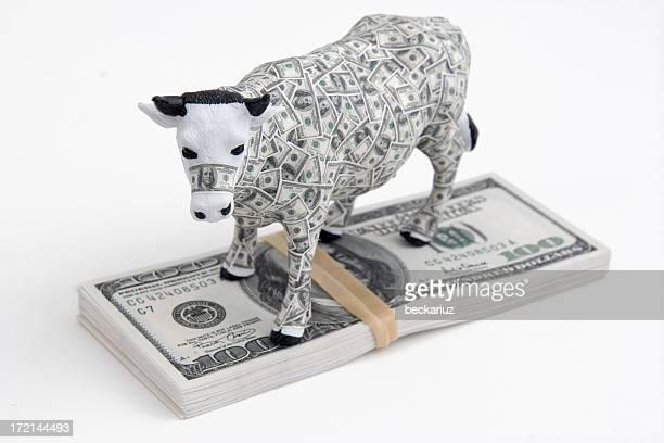 Cash Cow on pile of $ Money Bills
