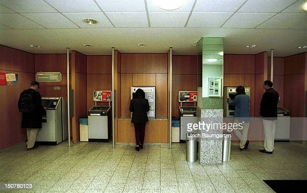Cash dispenser and bank statement printer in the foyer of one saving bank branch in Bonn
