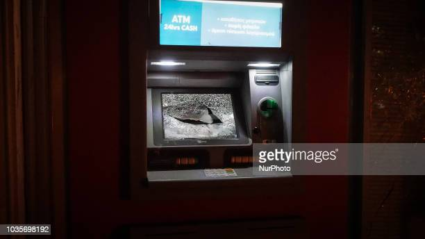 A cash machine is smashed by protesters during the 5th Anniversary of the murder of Pavlos Fyssas