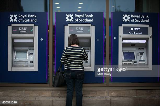 ATM cash machines are seen outside a branch of the Royal Bank of Scotland is seen ahead of the Scottish Referendum on September 12 2014 in Edinburgh...