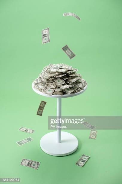 cash raining onto table - exceed and excel stock pictures, royalty-free photos & images