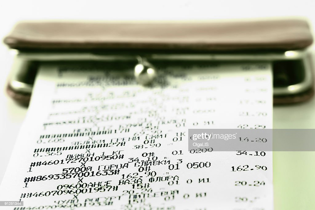cash receipt on background of a purse stock photo getty images
