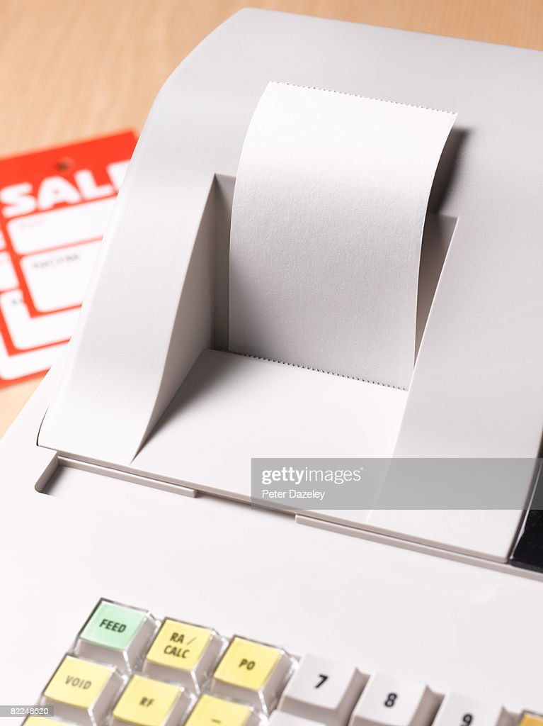 Cash register with blank receipt : Stock Photo