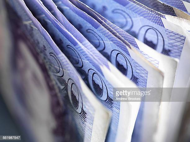 cash savings - british pound sterling note stock pictures, royalty-free photos & images