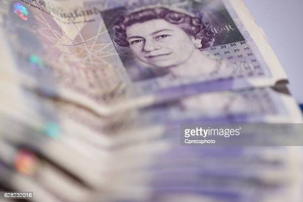 cash savings, pounds - twenty pound note stock photos and pictures