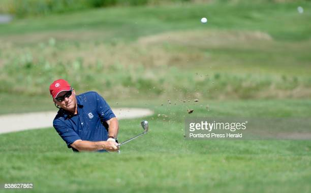 Cash Wiseman of the Falmouth Country Club chips out of a sand trap on the 16th hole of the Senior Amateur Golf Championship at the Falmouth Country...
